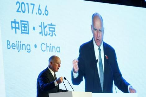 California Governor Jerry Brown attends International Forum on Electric Vehicle Pilot Cities and Industrial Development in Beijing