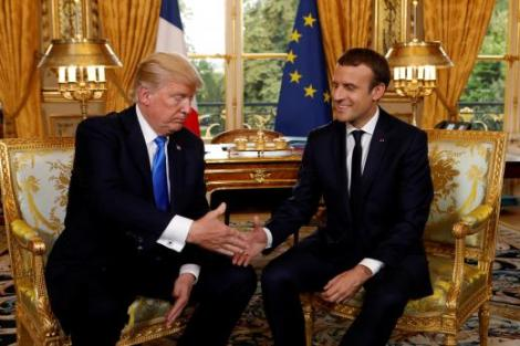 French President Emmanuel Macron and US President Donald Trump shake hands at the Elysee Palace in Paris