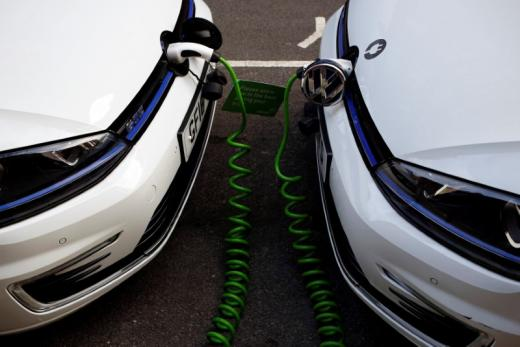 FILE PHOTO: Electric Volkswagen cars are plugged into a recharging point in central London