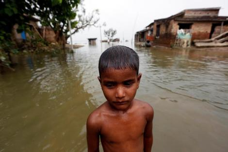 Boy is pictured in a flooded village in Motihari