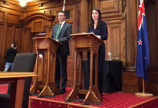 New Zealand's Prime Minister-designate Jacinda Ardern speaks as she stands next to New Zealand Green Party leader James Shaw in Wellington