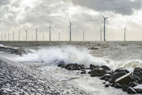 Wind turbines on land and offshore in a storm