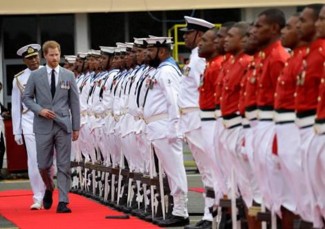 Britain's Prince Harry inspects a guard of honour on his arrival in Suva