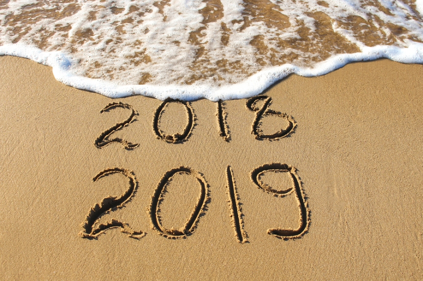 2019, 2018 Years Written On Sandy Beach Sea. Wave Washes Away 20