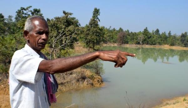 Byasadev Bhoi of Pandel village says the irrigation pond changed his life (Photo by Basudev Mahapatra)