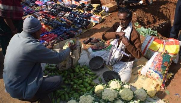 Chhala Bhoi of Pandel village sells vegetable grown in his field at Tusura haat (Photo by Basudev Mahapatra)